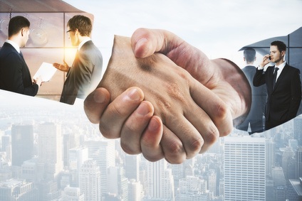 businessmen handshake and other business people